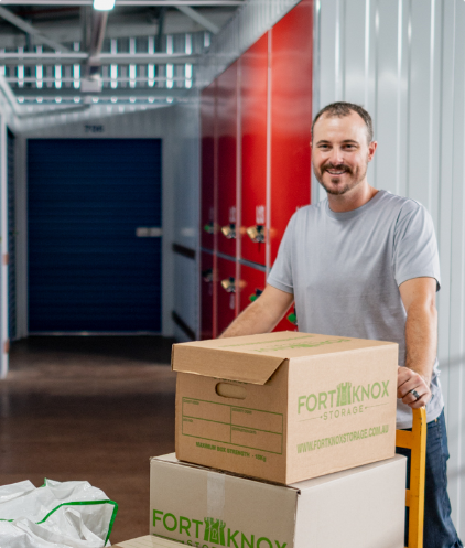 Person using a trolley to move Fort Knox Storage boxes