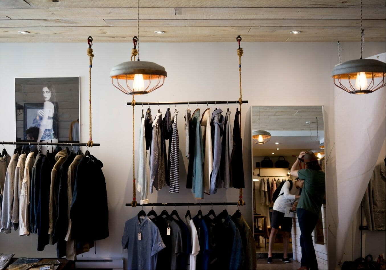 Clothes hanging on clothing racks