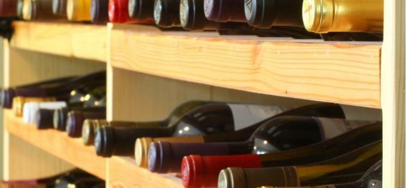 Wine bottles on a storing rack
