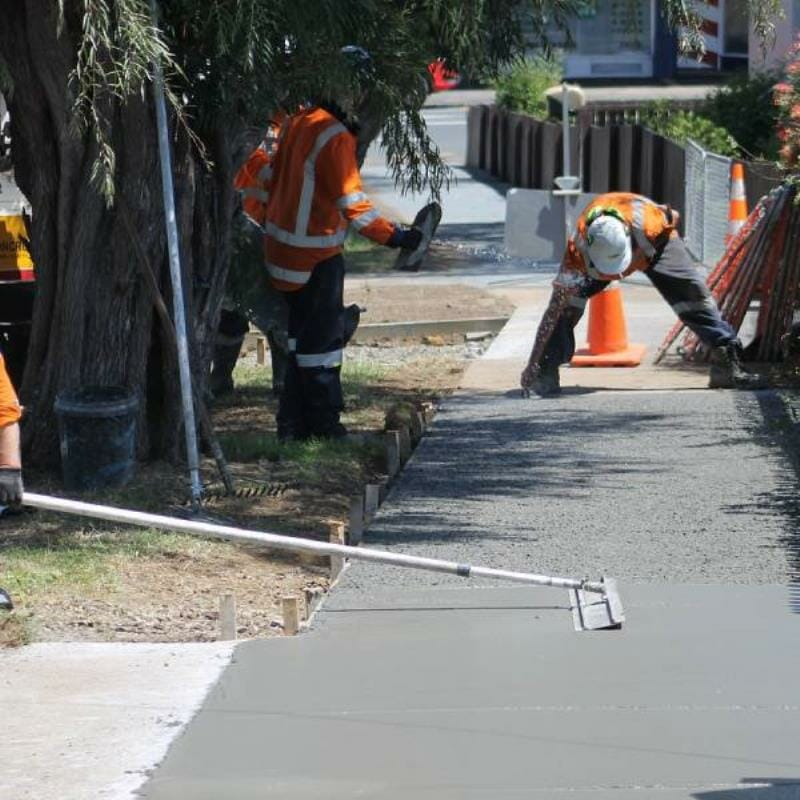 People concreting a footpath