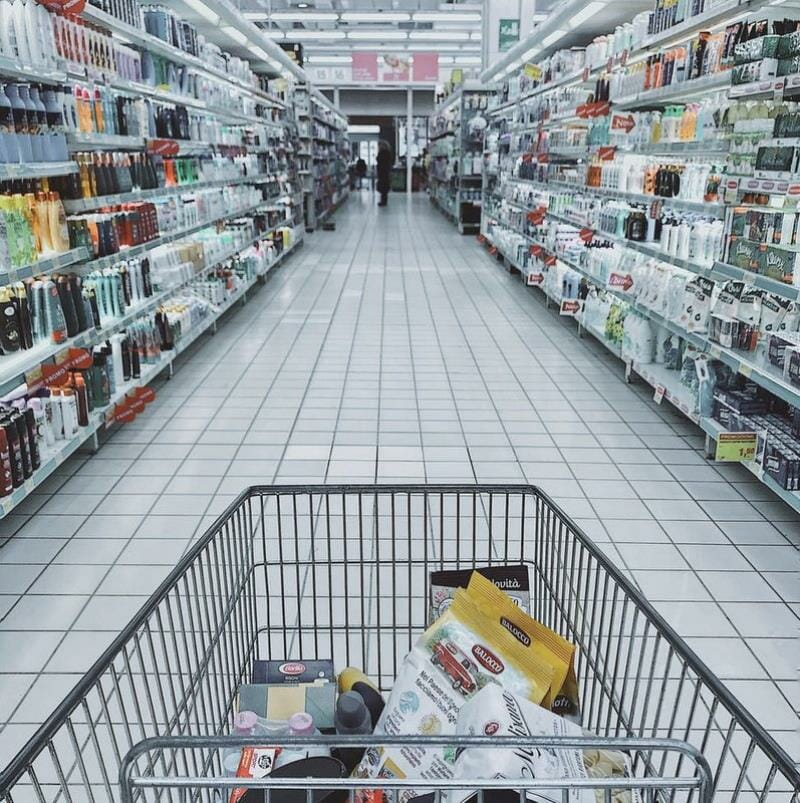 A shopping cart in a store aisle